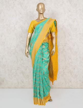 Aqua blue and yellow muga silk saree for festive