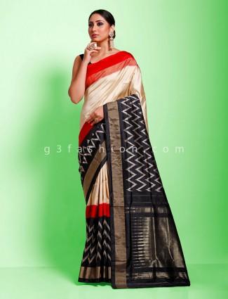 Cream and black contrast zigzag hydrabadi ikkat patola sari