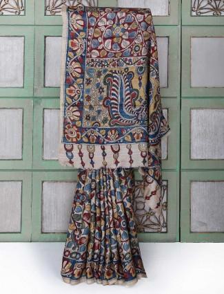 Beige color silk ikkat printed saree