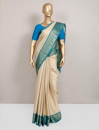 Beige festive wear saree in semi silk