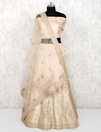 Beige hue raw silk semi stitched wedding lehenga choli