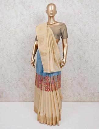 Beige silk saree with thread zari embellishment.