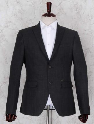 Black hued green shaded solid blazer