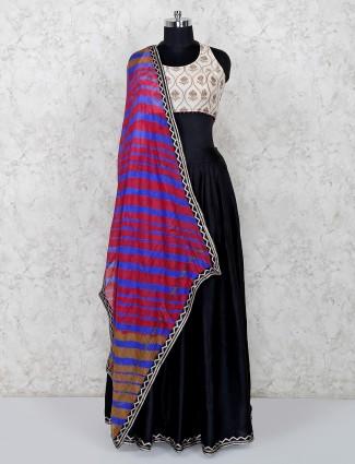 Black lehenga and beige blouse with leheriya dupatta