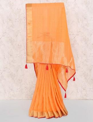 Checks pattern peach colored saree