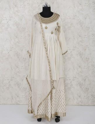 Cotton silk cream hue party punjabi lehenga suit