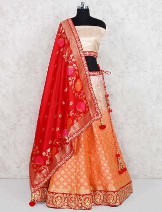 Cream and orange shaded banarasi silk semi stitched lehenga choli