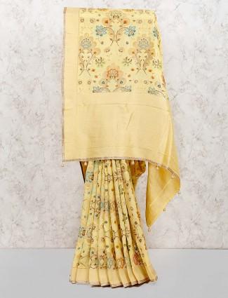 Cream color festive wear muga silk saree