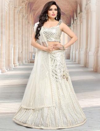 Cream color net festive wear lehenga choli