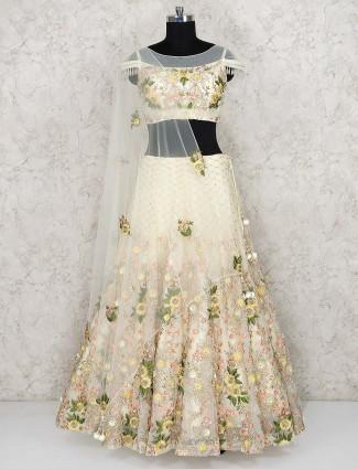 Cream color net wedding lehenga choli