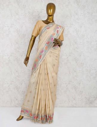 Cream color wedding function semi silk saree
