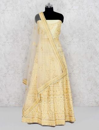 Cream hue silk fabric semi stitched lehenga choli