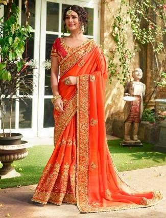 Exclusive orange colored raw silk saree
