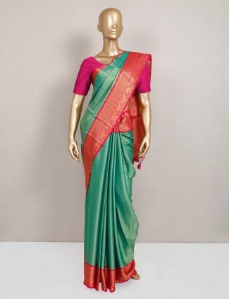 Festive wear semi silk saree in green