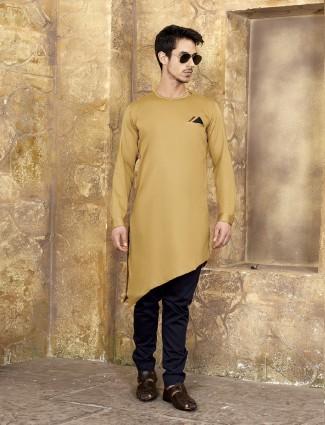 Gold colored festive wear kurta suit