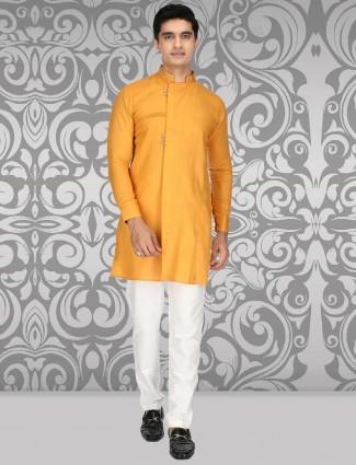 Gold hued cotton designer sober kurta suit