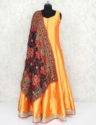 Golden hue raw silk floor length anarkali salwar suit