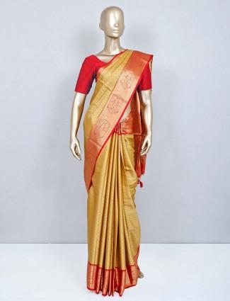 Golden south silk saree with zari weaving border