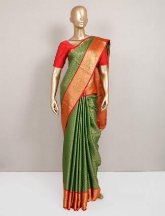 Green festive wear designer semi silk sari