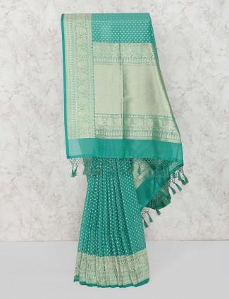 Green hue semi silk festive wear saree