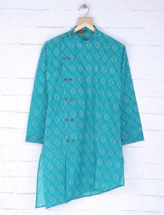 Green hued cotton printed pattern kurta suit