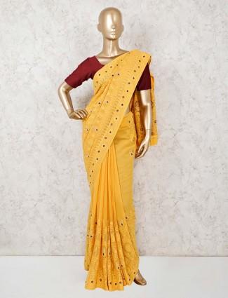 Haldi function wear yellow georgette sari