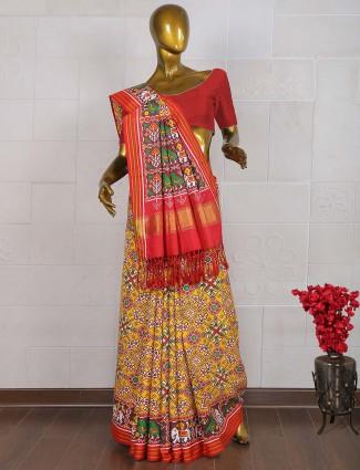 Lemon yellow and red patan patola saree for wedding