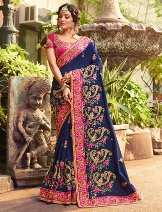 Navy hue satin fabric saree for wedding occasion