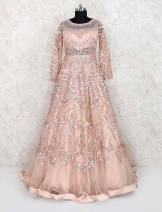 Net fabric peach color floor length gown