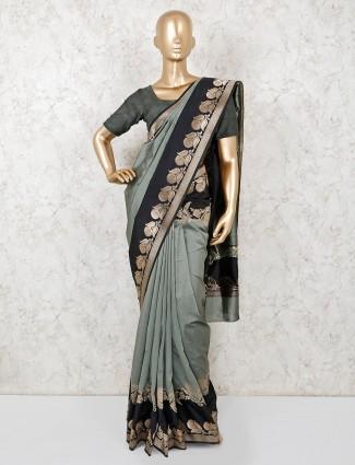 Olive green designer semi silk sari
