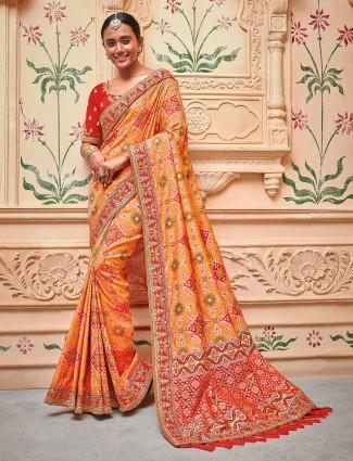 Orange color patola design semi silk saree