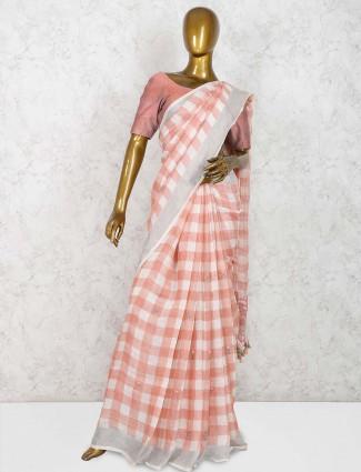 Peach and white linen saree in checks pattern