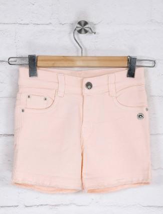 Peach solid denim shorts