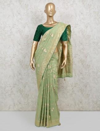 Pista green latest saree in dola silk for wedding