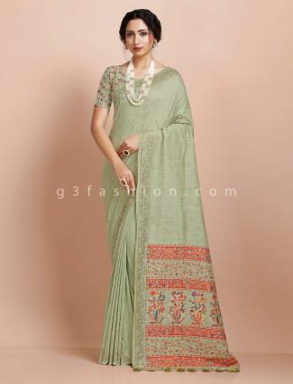 Pista green pashmina silk saree with contrast thread weaving pallu