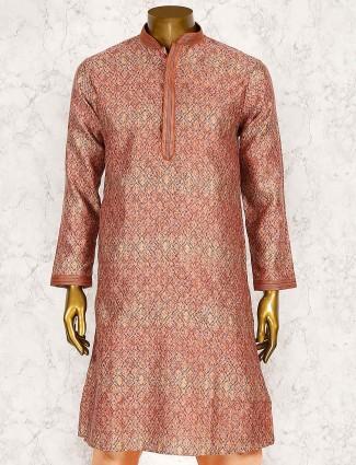 Printed orange hued cotton silk kurta suit