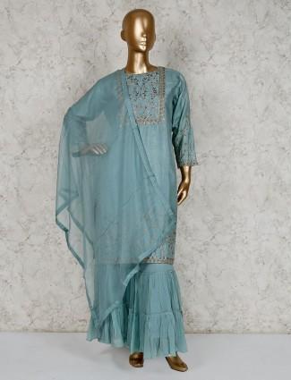 Punjabi sharara suit in teal green cotton silk