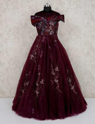 Purple net wedding wear designer gown