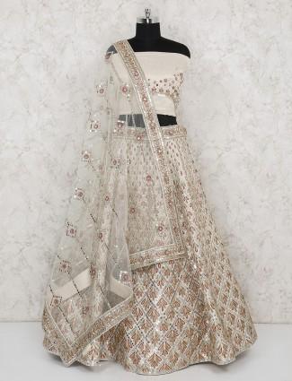 Raw silk bridal wear beige semi stitched lehenga choli