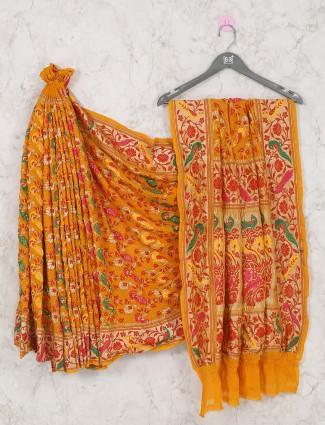 Stylish yellow colored bandhani saree for bride