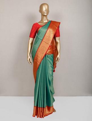 Teal green semi silk saree design for festive occasion