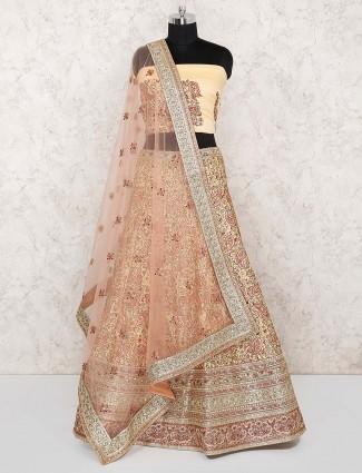 Wedding wear cream hue silk semi stitched lehenga choli