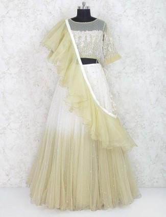 White and green net lehenga choli