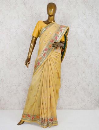 Yellow hue semi silk saree for wedding