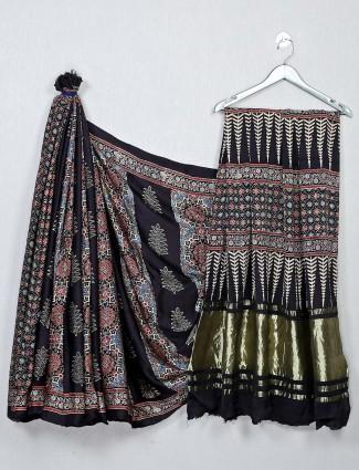 Alluring black color festive wear bandhej saree