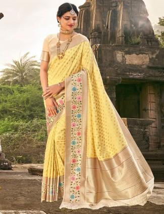 Amazing yellow banarasi silk saree for wedding occasions
