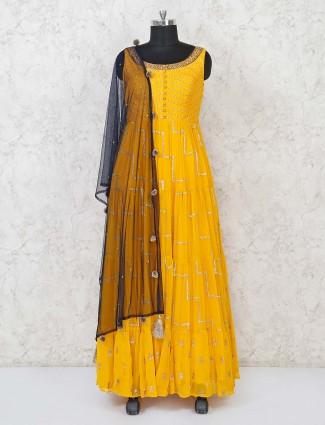 Anarkali floor length suit in yellow georgette