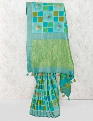 Aqua and green festive wear saree