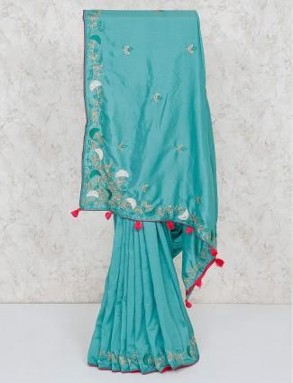 Aqua green festive semi silk saree