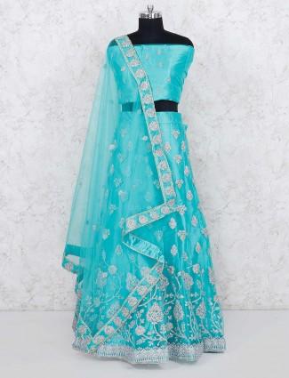 Aqua green semi stitched lehenga choli in net fabric